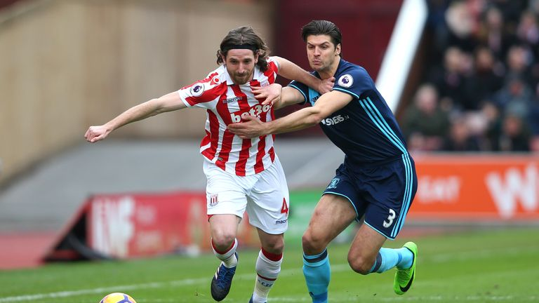 Joe Allen and Kevin Friend tussle at the bet365 Stadium