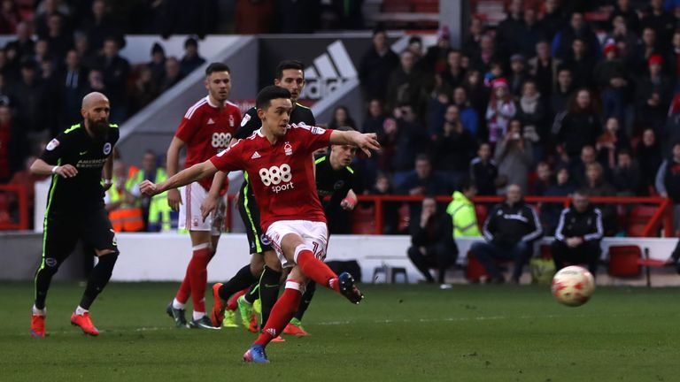 Zach Clough scores his side's third goal from the penalty spot