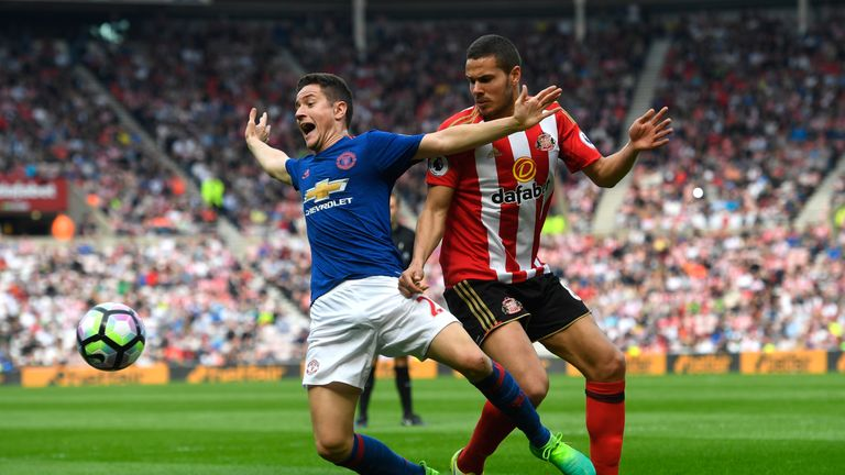Ander Herrera is challenged by Jack Rodwell in the first half