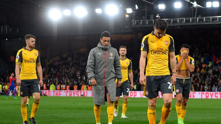 Arsenal's players trudge off after losing to Crystal Palace