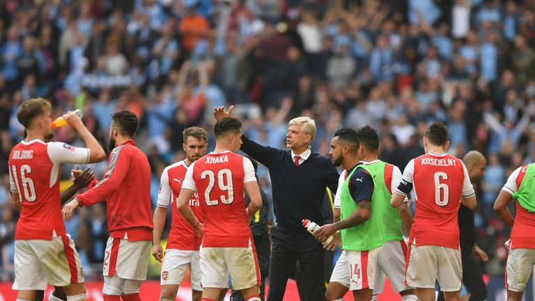 Wenger gives his players a team talk during the FA Cup semi-final win over Man City