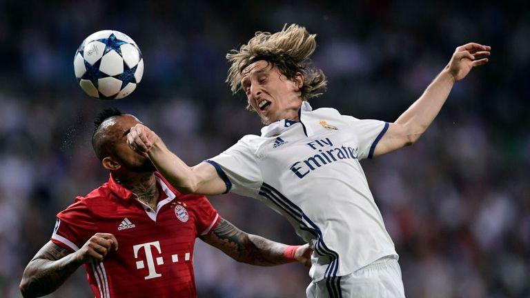 Arturo Vidal (left) vies with Real Madrid midfielder Luka Modric