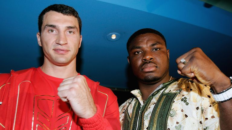Klitschko and Samuel Peter pose together at a pre-fight press conference