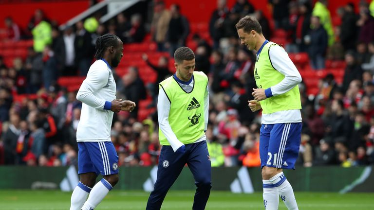 Chelsea's Victor Moses (L - R), Hazard and former Chelsea  midfielder Nemanja Matic warm up last season's match at Manchester United