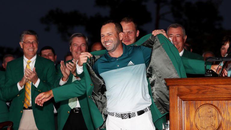 Danny Willett helps Garcia into the Green Jacket