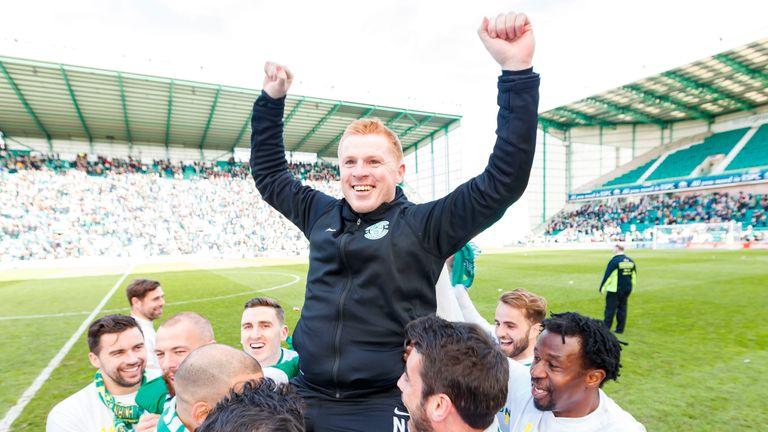 Neil Lennon celebrates promotion with his Hibernian team