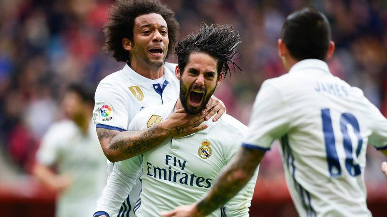 Isco celebrates his late winner with team-mate Marcelo