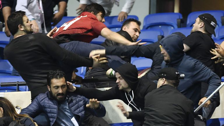Violence broke out between Besiktas and Lyon supporters inside the stadium