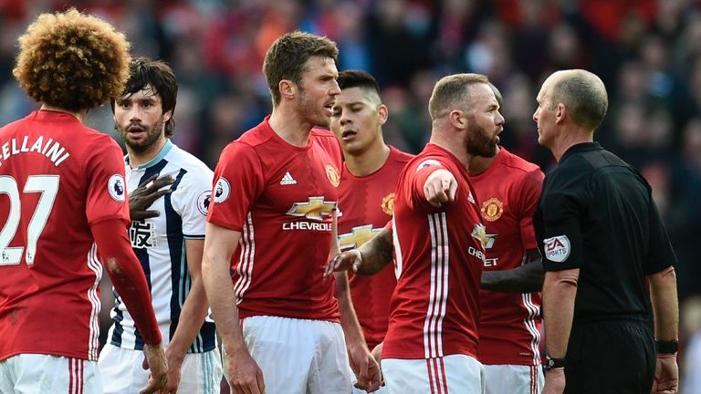 Wayne Rooney and Michael Carrick show their frustration