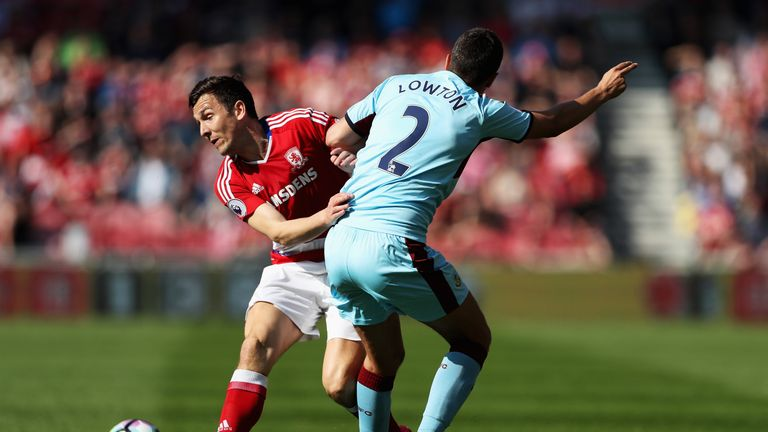 Stewart Downing of Middlesbrough and Matthew Lowton battle for possession