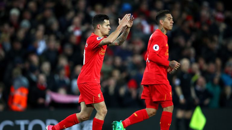 Philippe Coutinho celebrates after scoring Liverpool's equaliser