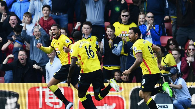 Etienne Capoue is pursued by team-mates while celebrating his goal against Swansea.