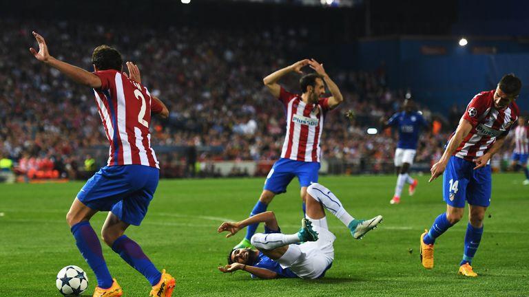 Riyad Mahrez goes to ground after a challenge by Gabi (R) of Atletico Madrid