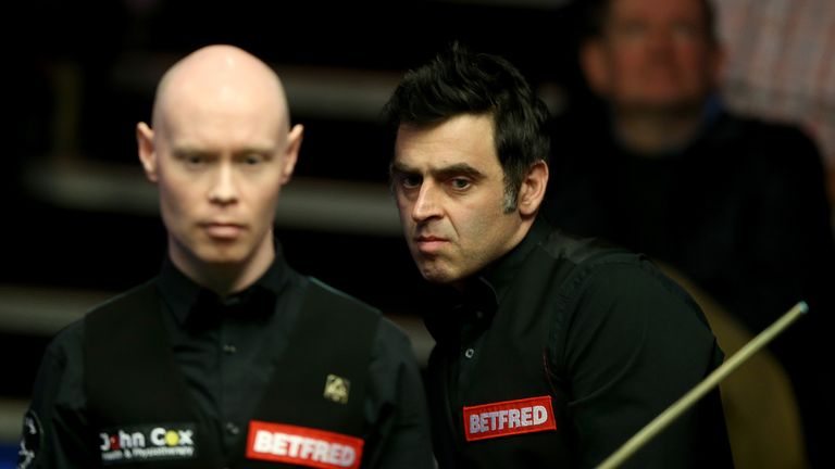 Ronnie O'Sullivan (R) and Gary Wilson during their first round match on day one of the World Championships