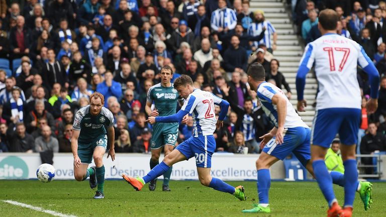 Solly March added a second before Nick Powell pulled one back for Wigan