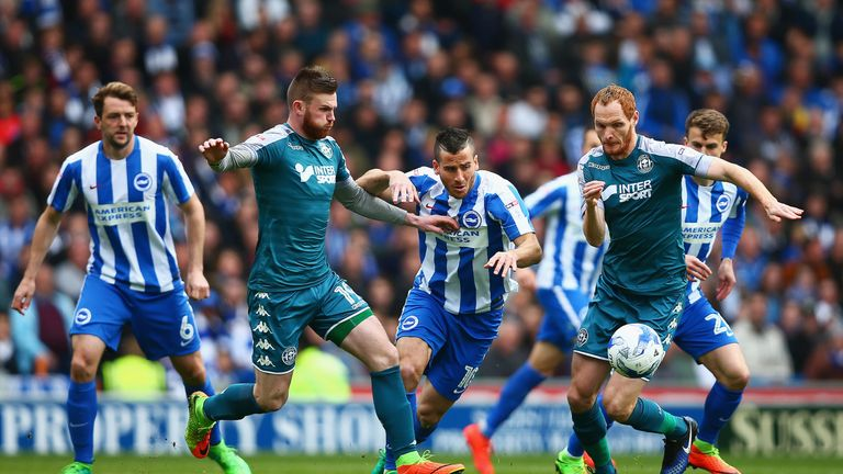 Millwall's new signing Ryan Tunnicliffe (L) spent time on loan at Wigan last season