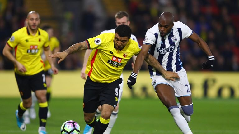 Deeney tussles with Allan Nyom during the early stages at Vicarage Road