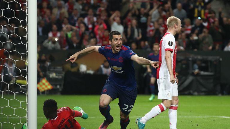 Henrikh Mkhitaryan celebrates after netting the second