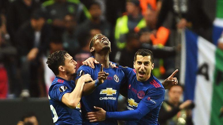 Paul Pogba celebrates scoring the first goal with Henrikh Mkhitaryan.