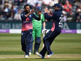 England's Adil Rashid celebrates after dismissing Ireland's Stuart Thompson