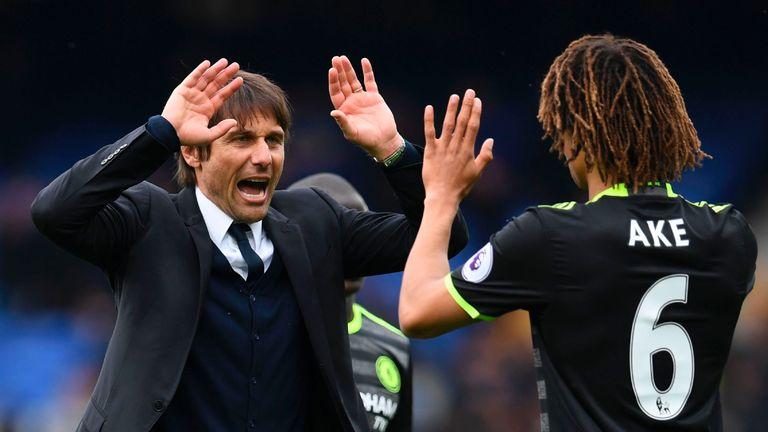 Antonio Conte celebrates Chelsea's win with Nathan Ake