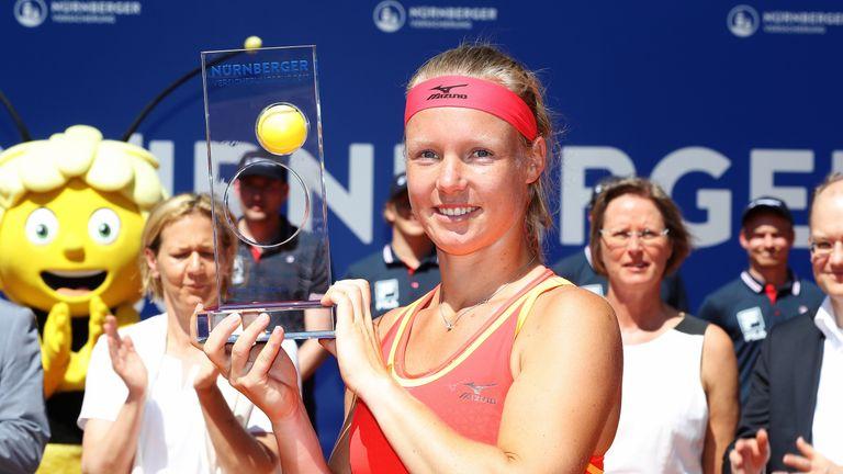 Kiki Bertens celebrates with the Nuremberg trophy after winning against Barbora Krejcikova
