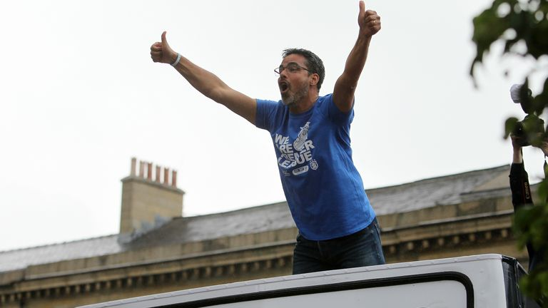David Wagner celebrates with fans during Huddersfield's promotion parade