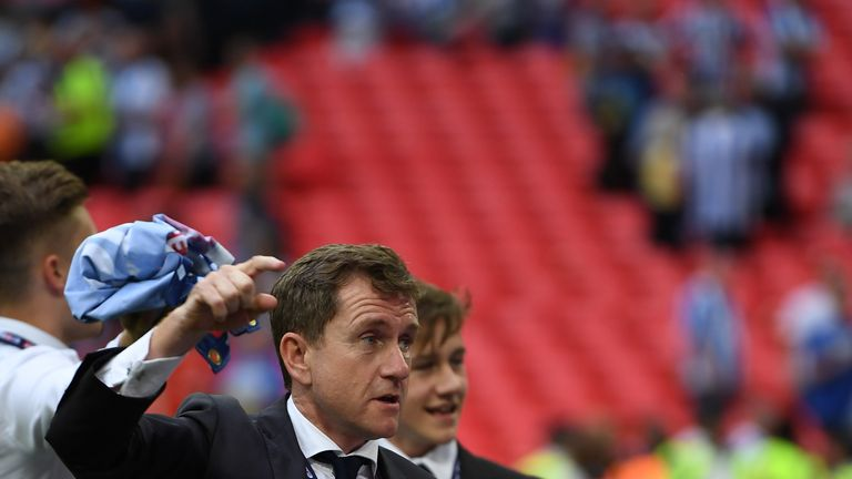 Dean Hoyle, chairman of Huddersfield Town, says it is the toughest decision he has undertaken in his time at the club