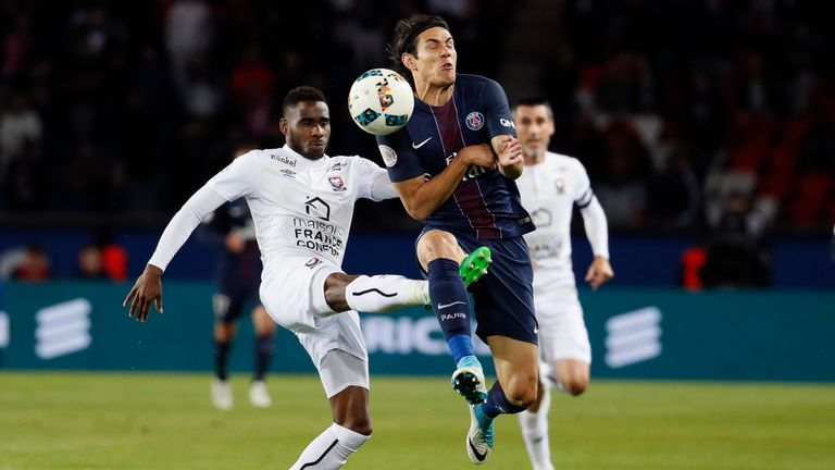 Caen secured their top-flight status with a battling draw with PSG