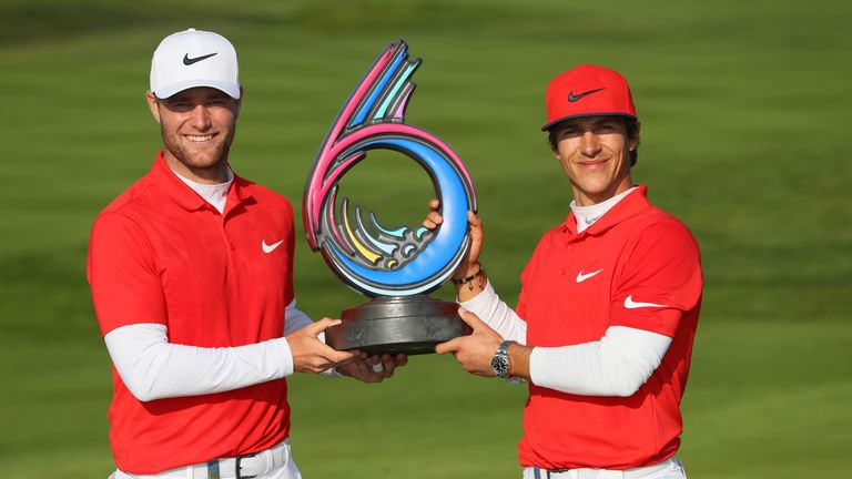 Thorbjorn Olesen and Lucas Bjerregaard of Denmark pose with the trophy after winning the final match against Australia