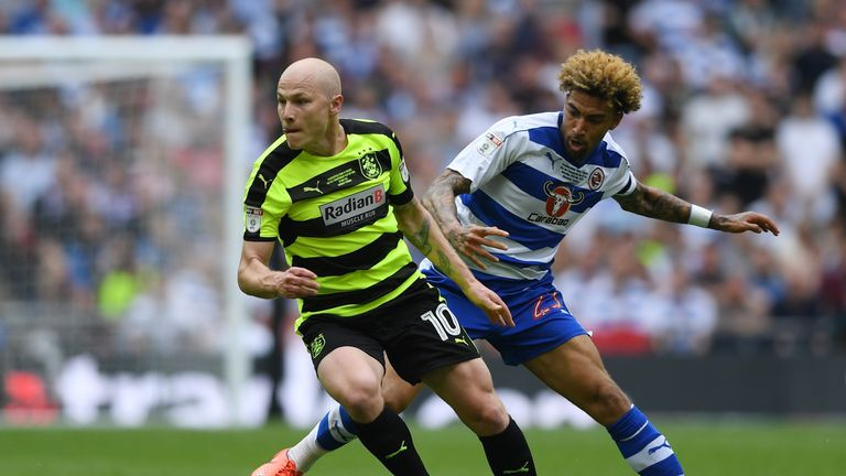 Aaron Mooy of Huddersfield Town attempts to get away from Reading's Daniel Williams
