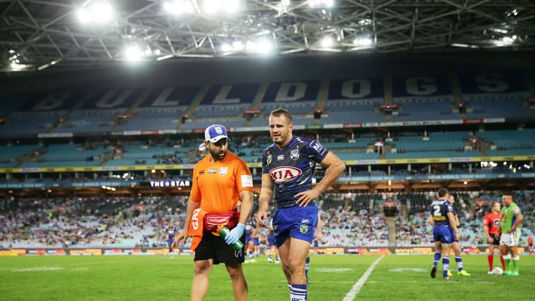 Josh Reynolds of the Bulldogs leaves the field with an injury