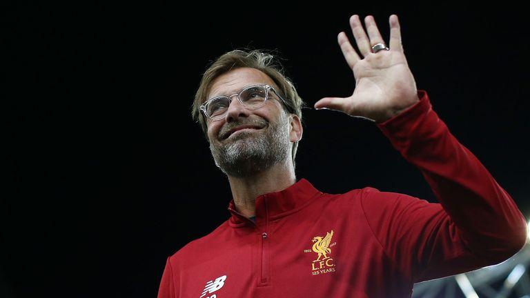 Liverpool manager Jurgen Klopp waves to fans
