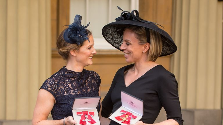 Kate Richardson-Walsh (r) and her wife Helen at Buckingham Palace after their investiture ceremony in February