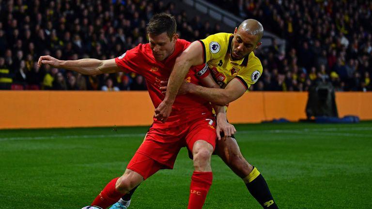 Milner of Liverpool is tackled by Nordin Amrabat of Watford