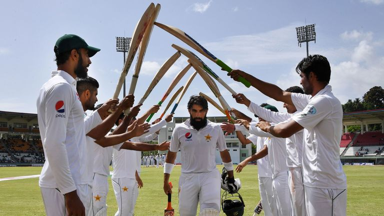 Misbah-ul-Haq receives a guard of honour from his team-mates
