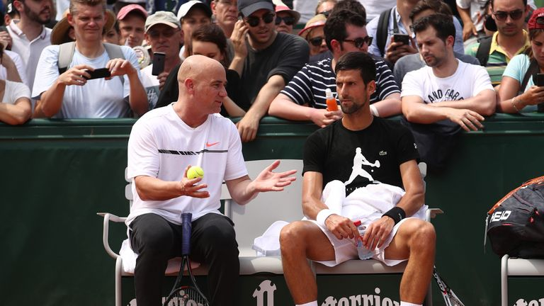 Novak Djokovic (right) is working alongside Andre Agassi at the French Open