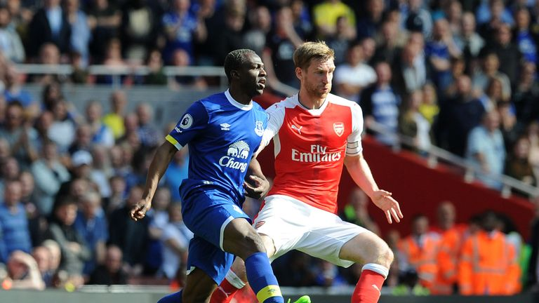 Per Mertesacker (R) could start for Arsenal