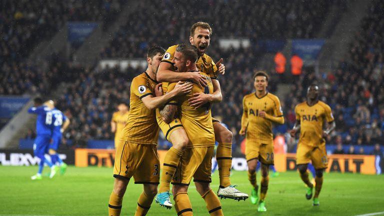 Kane celebrates Spurs' third goal with team-mates at the King Power