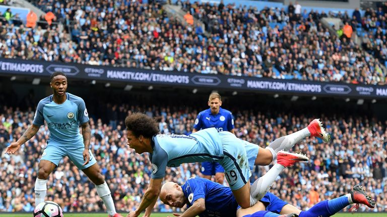 Leroy Sane is brought down in the box by Yohan Benalouane