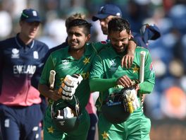 Pakistan's Babar Azam and Mohammad Hafeez celebrate victory