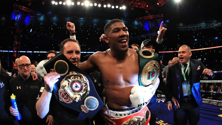 Joshua celebrates with two world titles after win over Klitschko
