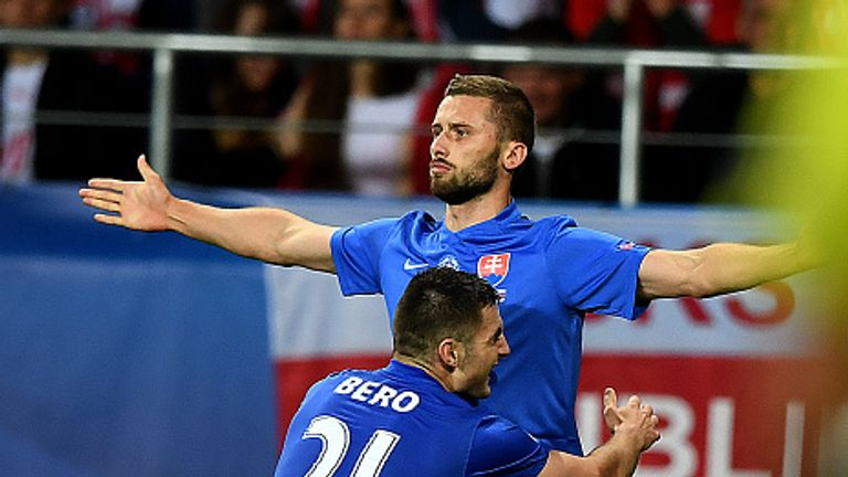 Matus Bero celebrates with Pavol Safranko