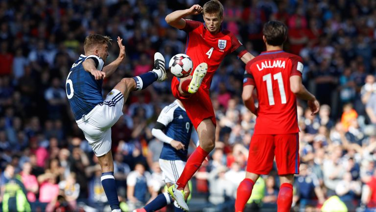 James Morrison and Eric Dier battle for the ball