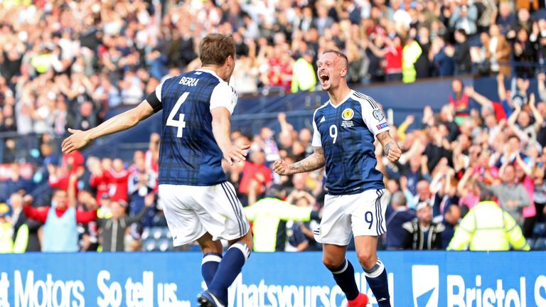 Leigh Griffiths (right) celebrates against England, but his heroics proved to be in vain