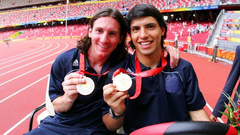 Messi celebrates his 2008 Olympics win with Sergio Aguero