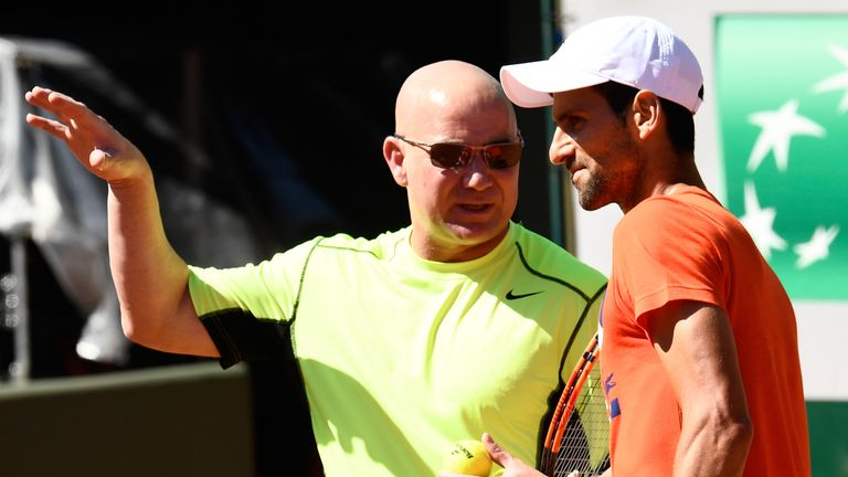 Novak Djokovic (R) and his coach Andre Agassi at Roland Garros