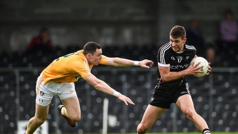 Sligo's Niall Murphy in action against Declan Lynch of Antrim