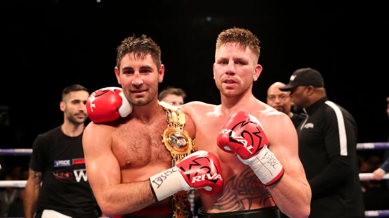 The two fighters embrace after 12 rounds of action