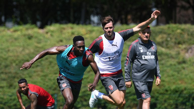 Carl Jenkinson (R) battles for the ball with Danny Welbeck